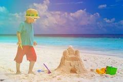 Little boy building sand castle on beach Stock Photography