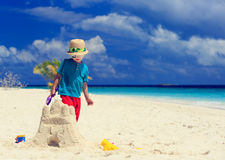 Little boy building sand castle on beach Royalty Free Stock Photography