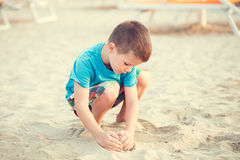 Little boy building sand fortress on beach Royalty Free Stock Photography
