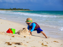 Little boy building sandcastle on the beach Royalty Free Stock Images
