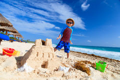 Little boy building sandcastle on tropical beach Royalty Free Stock Images