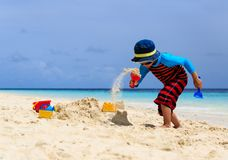 Little boy building sandcastle on tropical beach Royalty Free Stock Image