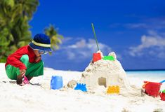 Little boy building sandcastle on tropical beach Royalty Free Stock Photography