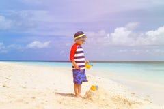 Little boy building sandcastle on tropical beach Royalty Free Stock Photography