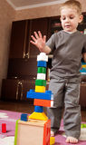 Little boy is building tower Stock Image