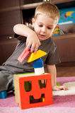 Little boy is building tower Stock Photography