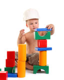 Little boy builds a house of toys Stock Images