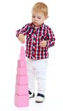 Little boy builds Red Pyramid, Montessori Royalty Free Stock Images