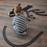 Little boy builds toy railroad Royalty Free Stock Photography