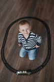 Little boy builds toy railroad Stock Image