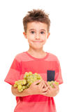 Little boy with bunch of grapes Stock Image