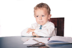 Little boy in a business suit all the cases decided. At the end of the working day Royalty Free Stock Photos