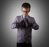 Little Boy in a Business Suit and boxing gloves Royalty Free Stock Photography