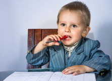 Little boy in a business suit came the idea Royalty Free Stock Photos