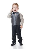 The little boy in a business suit speaks by phone Stock Photo