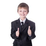 Little boy in business suit thumbs up  on white Royalty Free Stock Image