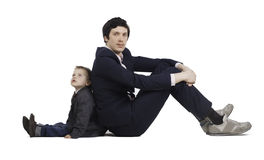 Little boy and businessmen communicate, isolation Stock Image