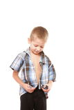 Little boy buttoning on shirt, isolated on white Stock Photography