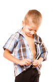 Little boy buttoning on shirt, isolated on white Stock Images