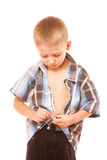 Little boy buttoning on shirt, isolated on white Royalty Free Stock Photos