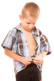 Little boy buttoning on shirt, isolated on white Royalty Free Stock Image