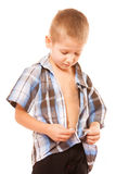 Little boy buttoning on shirt, isolated on white Royalty Free Stock Photo