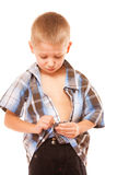 Little boy buttoning on shirt, isolated on white Stock Photos