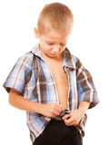 Little boy buttoning on shirt on white Stock Photo