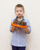 Little boy with a cake and dirty face Stock Photos