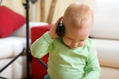 Little Boy Call By Wireless Phone At Home Royalty Free Stock Image