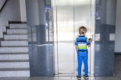 Little boy is calling the elevator Royalty Free Stock Photo