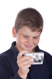 Little boy with the camera. On a white background Royalty Free Stock Image