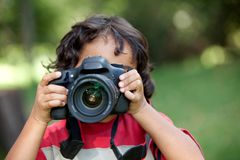 Little boy with a camera Royalty Free Stock Photography