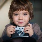 Little boy with a camera Stock Photos