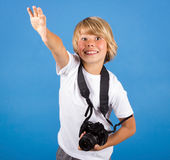 Little boy with camera Stock Images