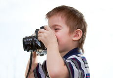 Little boy with a camera in his hands Royalty Free Stock Photo