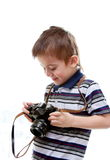 Little boy with a camera in his hands Stock Photos