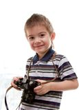 Little boy with a camera in his hands Stock Images