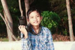 Little boy with a camera stock photography