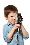 Little boy cameraman filming with retro camera Stock Image