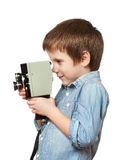 Little boy cameraman filming with retro camera Stock Photo