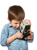 Little boy cameraman filming with retro camera Royalty Free Stock Image