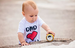 Little boy with can Stock Photography