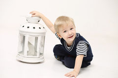Little boy and the candle holder Stock Photos