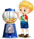 Little boy by the candy machine Stock Images