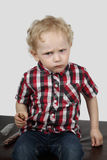 Little boy with candy Stock Photos