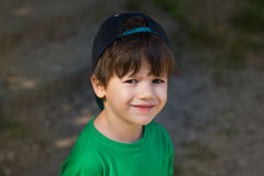 Little boy in cap back smile Stock Photo