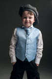 Little boy in cap and blue vest Royalty Free Stock Images