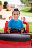 Little boy in cap drive Stock Photography