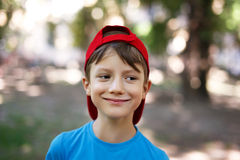 Little boy in cap look away Stock Photography